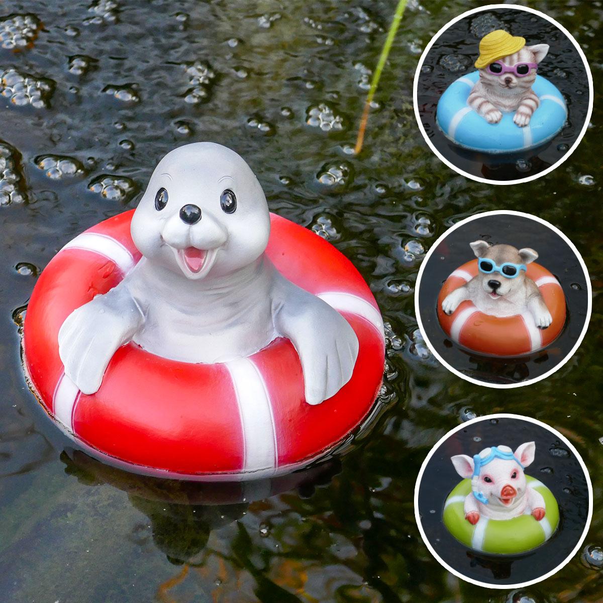 Lustige Teich-Figuren im Schwimmreifen Image